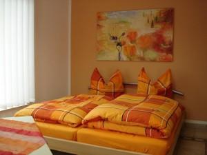 Schlafbereich I der Ferienwohnung mit Bett